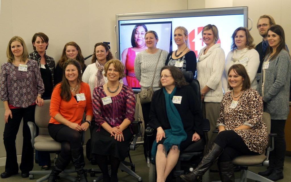 The Technology for HOME staff, independent consultants, and Melanie Fry pose for pictures at the Circle of Excellence award ceremony.